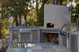 Outdoor kitchen with wood burning oven